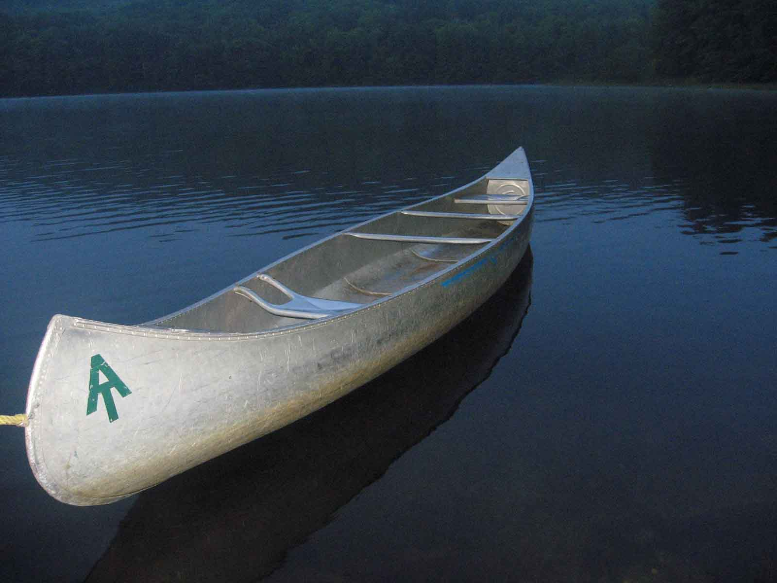 The caretakers canoe by Upper Goose Pond.