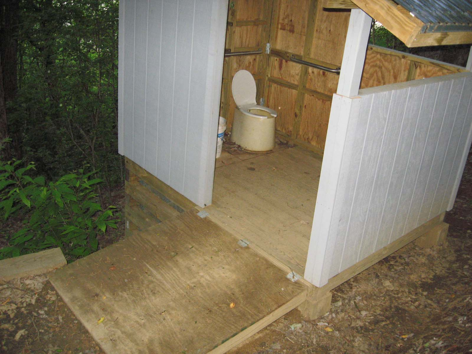 NC state regulations call for handicap accessible privies on top of a completely inaccessible mountain.